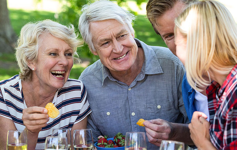 People smiling and eating together